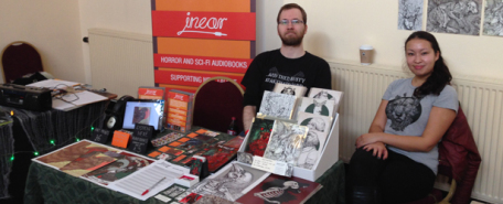 Thierry Heles and Michelle Harvey man the joint In Ear/Harvey Art stand at SCARdiff 2014.